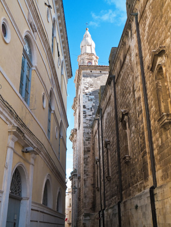 characteristic: This is a characteristic alley with catheral belltower in Monopoli. Apulia. Stock Photo