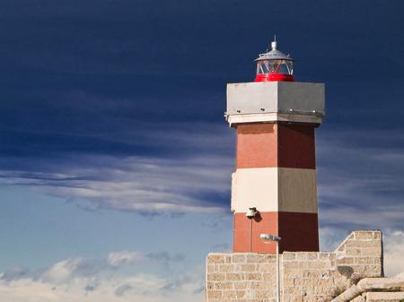 Monopoli seaport lighthouse at dusk. Apulia.