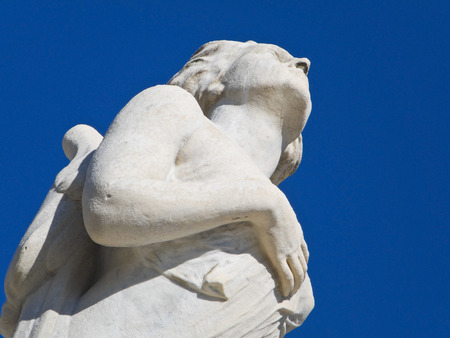 tribute: Marble Statue on blue sky. Stock Photo