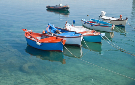 rowboats: Rowboats in clear sea.