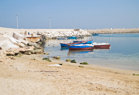 fishing boats: Fishing boats moored at Giovinazzo beach. Stock Photo