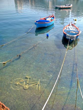 rowboats: Boats on clear sea.
