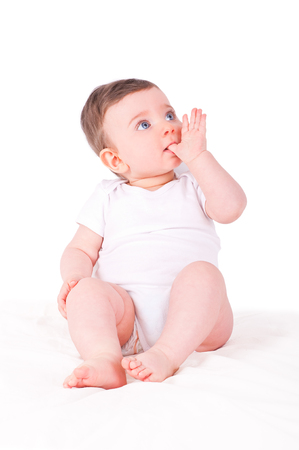 finger in mouth: Baby girl with finger In her mouth.