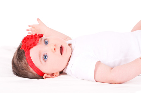 bandeau: Baby girl with red ribbon.