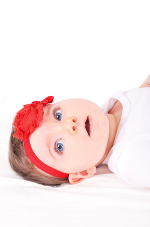 Baby girl with red ribbon.