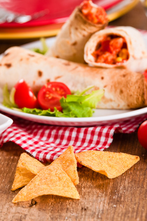 filled roll: Tortilla wraps with chicken and vegetable.
