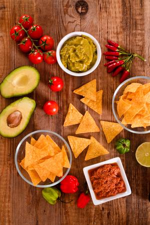 tex mex: Guacamole and nacho chips. Stock Photo