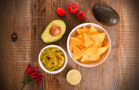 Guacamole dip and nacho chips.