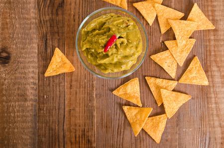 tex mex: Guacamole dip and nacho chips.