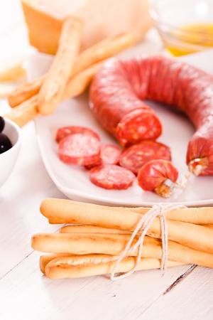 Grissini breadsticks with salami.