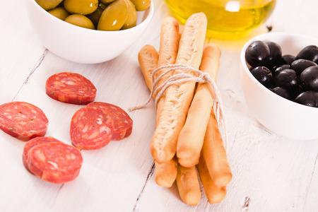 gressins: Grissini breadsticks with salami.