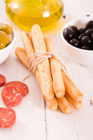 grissini: Grissini breadsticks with salami.