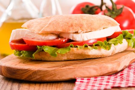 Puccia bread with mozzarella and tomato.