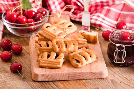 jam tarts: Cherry pastry pies. Stock Photo