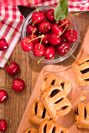 stuffing: Cherry pastry pies.  Stock Photo