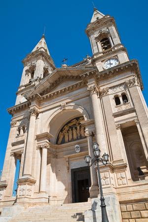 reloj de sol: Basilica Church of SS. Cosma e Damiano. Alberobello. Puglia. Italy.  Foto de archivo