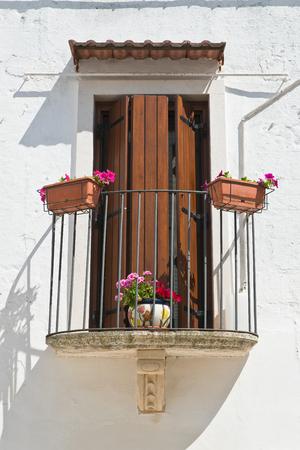 Balcony. Mottola. Puglia. Italy. Stock Photo