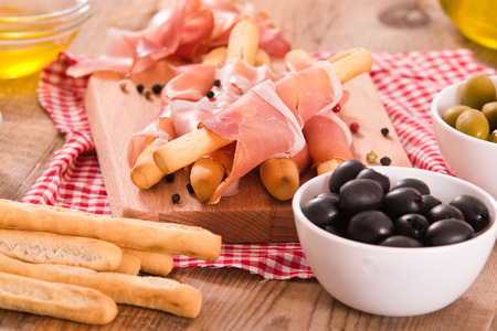 Grissini breadsticks with ham.