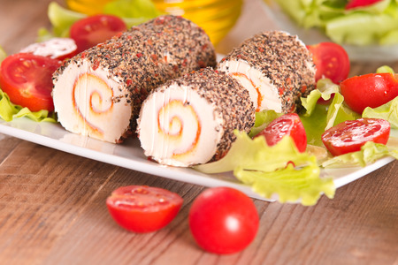 filled roll: Goat cheese with salad and cherry tomatoes.