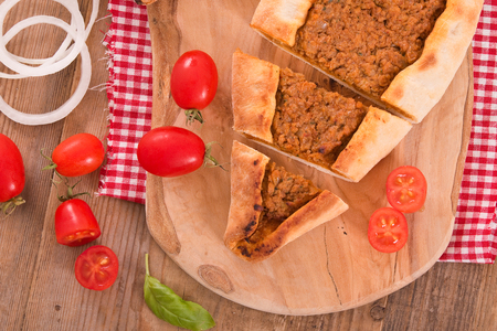 Turkish pide pizza with meat and onion.  Stock Photo
