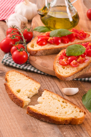 Bruschetta bread with basil and chopped tomatoes.
