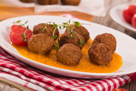 Meatballs with carrot pur?e. Stock Photo
