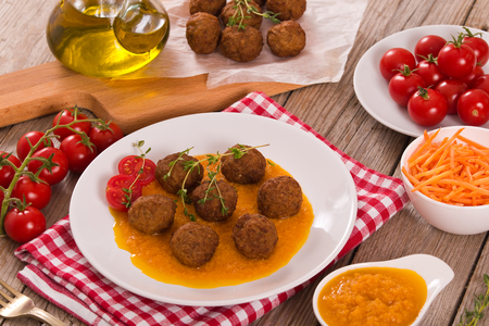 Meatballs with mashed carrots. Stock Photo