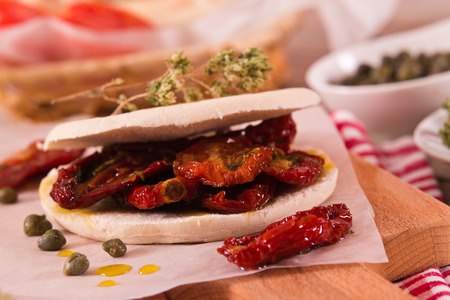 Tigella bread with sun-dried tomatoes. Archivio Fotografico - 118560545
