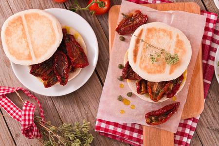 Tigella bread with sun-dried tomatoes. Archivio Fotografico - 118560546