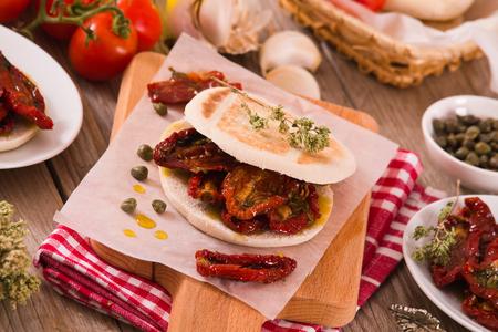 Tigella bread with sun-dried tomatoes. Archivio Fotografico - 119632734