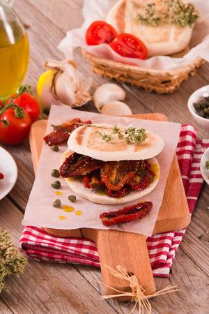 Tigella bread with sun-dried tomatoes. Archivio Fotografico - 122703098
