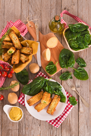 Potato croquettes with spinach and mozzarella.
