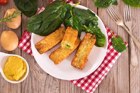 Potato croquettes with spinach and mozzarella. Stockfoto