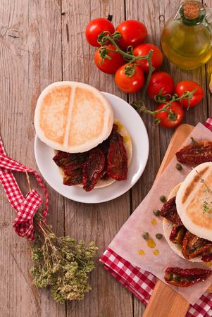 Tigella bread with sun-dried tomatoes. Archivio Fotografico - 123764910