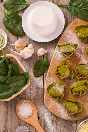 Spinach ravioli with ricotta cheese filling.