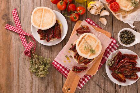Tigella bread with sun-dried tomatoes. Archivio Fotografico - 125809863