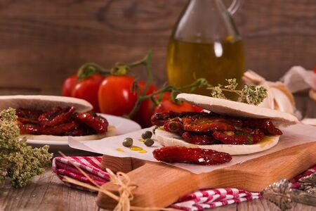 Tigella bread with sun-dried tomatoes. Archivio Fotografico - 125809870
