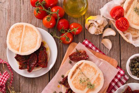 Tigella bread with sun-dried tomatoes. Archivio Fotografico - 125809881