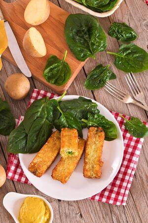 Potato croquettes with spinach and mozzarella.