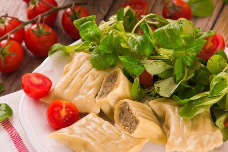 Maultaschen - swabian filled pasta ( ravioli ). Stock fotó