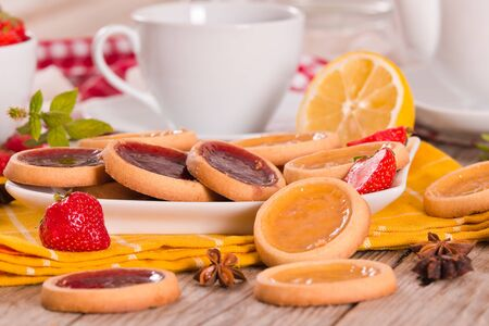 Lemon and straberry tartlets. Stock fotó