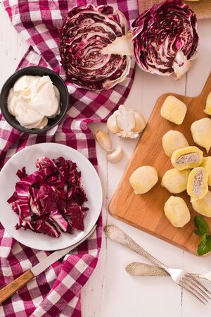 Potato gnocchi stuffed with radicchio and ricotta.