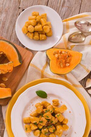 Pumpkin gnocchi with grated amaretti cookies.