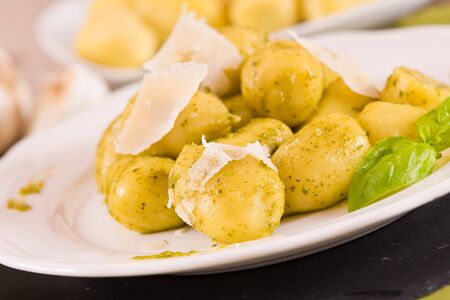 Potato gnocchi stuffed with pesto sauce.