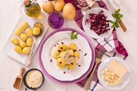 Potato gnocchi stuffed with radicchio and ricotta. Standard-Bild