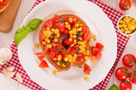 Friselle with tomatoes and mais.