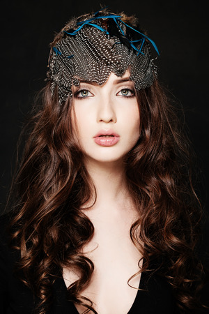 Fashion Woman. Long Curly Hairstyle and Make-up