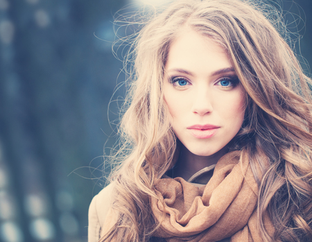 Attractive Woman Outdoors. Windy Hair, Cute Face Stock Photo