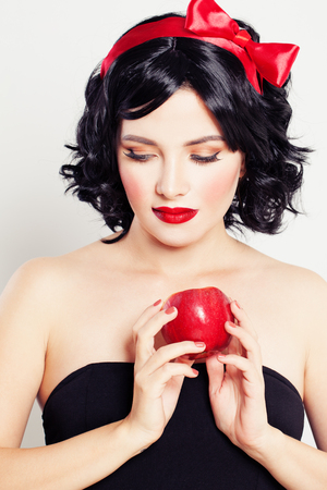 Cute Woman with Red Apple Fruit. Temptation Stock Photo
