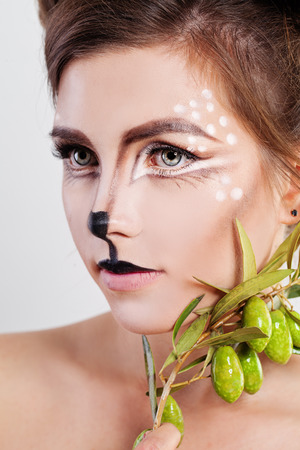 Young Woman Deer Animal. Face with Artistic Make-up